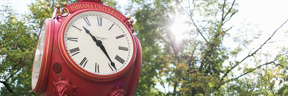 A closeup of a red outdoor clock on the IU Bloomington campus