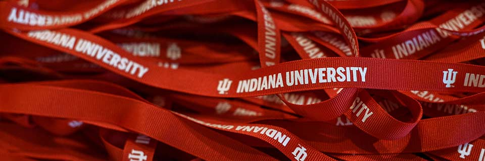 A pile of red lanyards with Indiana University printed on them