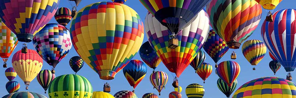Colorful hot air balloons rise into the sky