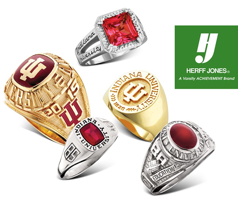Five styles of Indiana University class rings in gold and silver with Herff Jones logo